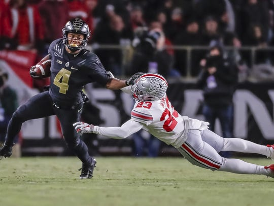 Purdue wide receiver Rondale Moore (4) runs away from Ohio State defender Jahsen Wint (23) at Ross-Ade Stadium on Oct. 20, 2018, in West Lafayette, Ind.