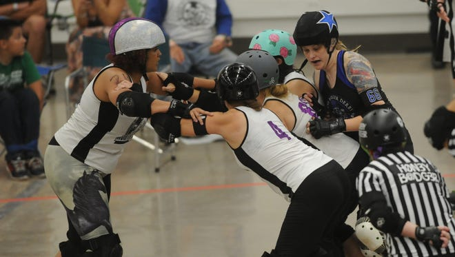 Abilene jammer G.G. Ellin, right, tries to get past a North Texas block during the Sugarbombs' game Saturday, June 24, 2017 at the Abilene Convention Center.