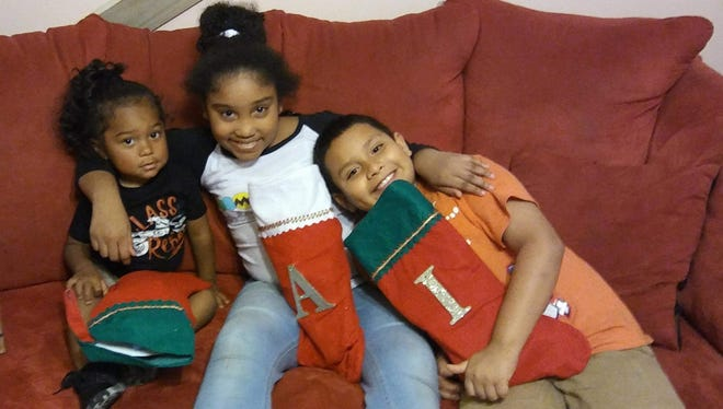 Issac Santillan of Fort Pierce, Fla., shown with Aryanna and Noah Santillan on Dec. 24, 2017, died early Christmas Day in a car wreck. Christmas also was his ninth birthday.