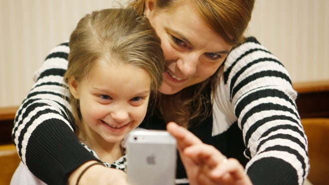 Danielle Watson of Springfield Township takes a selfie with her new little sister, Shyanne Watson, 4. Danielle, 25, was adopted by Gary and Cindy Watson when she was 7 years old.