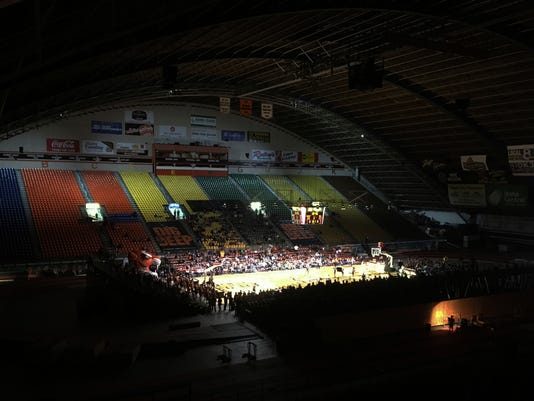 In this Jan. 6, 2018, photo, Northern Arizona plays Idaho State in a men's basketball game at Holt Arena in Pocatello, Idaho. The basketball court is set up at the north end of the multi-purpose arena with temporary bleachers on two sides. Holt Arena is also used for football, track and a variety of events in town. (AP Photo/John Marshall)