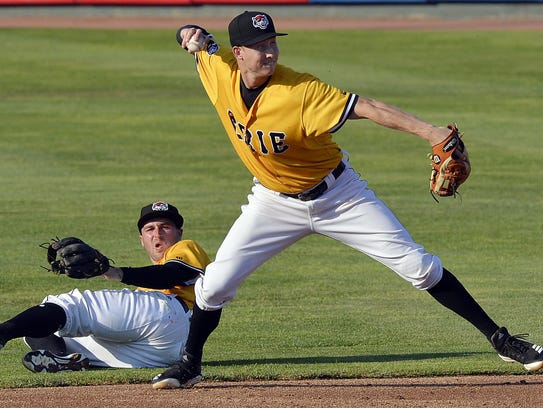Erie SeaWolves shortstop A.J. Simcox throws to first