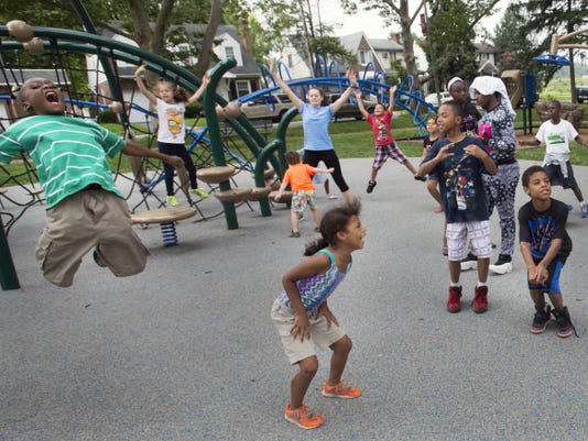 Communities in Schools program partnered with York City for its summer parks program to add an academic compontent. The day starts with children participating in an organized exercise program at Lincoln Park in York Tuesday.