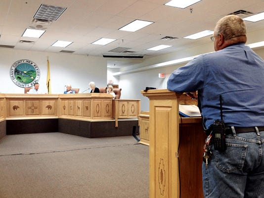 Grant County Commissioners Gabriel Ramos, from left, Brett Kasten and Ron Hall discuss county business during Tuesday's work session. Randal Seyler - Sun-News