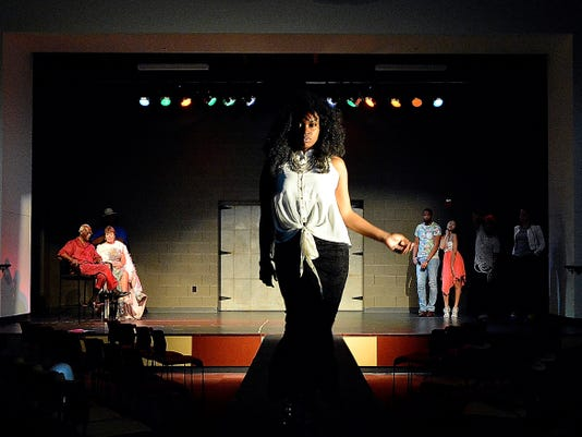 """Deona Blancher walks the runway during a dress rehearsal for """"Don't Judge a Soul by its Suit,"""" at Logos Academy, Tuesday July 21, 2015. Written by Jonathan and Cindy Strawbridge of York City, the play aims to challenge stereotypes and pre-judgments.  John A. Pavoncello - jpavoncello@yorkdispatch.com"""