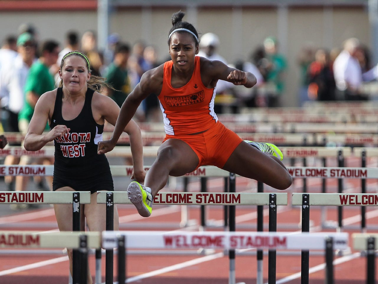 Withrow's Ayanna O'Neal races to an easy win in the 100 hurdles at the Division I regional finals.