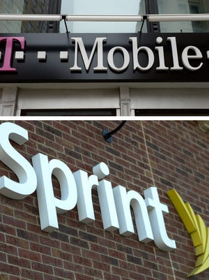 T-Mobile and Sprint signage. The two companies are reportedly in merger talks.