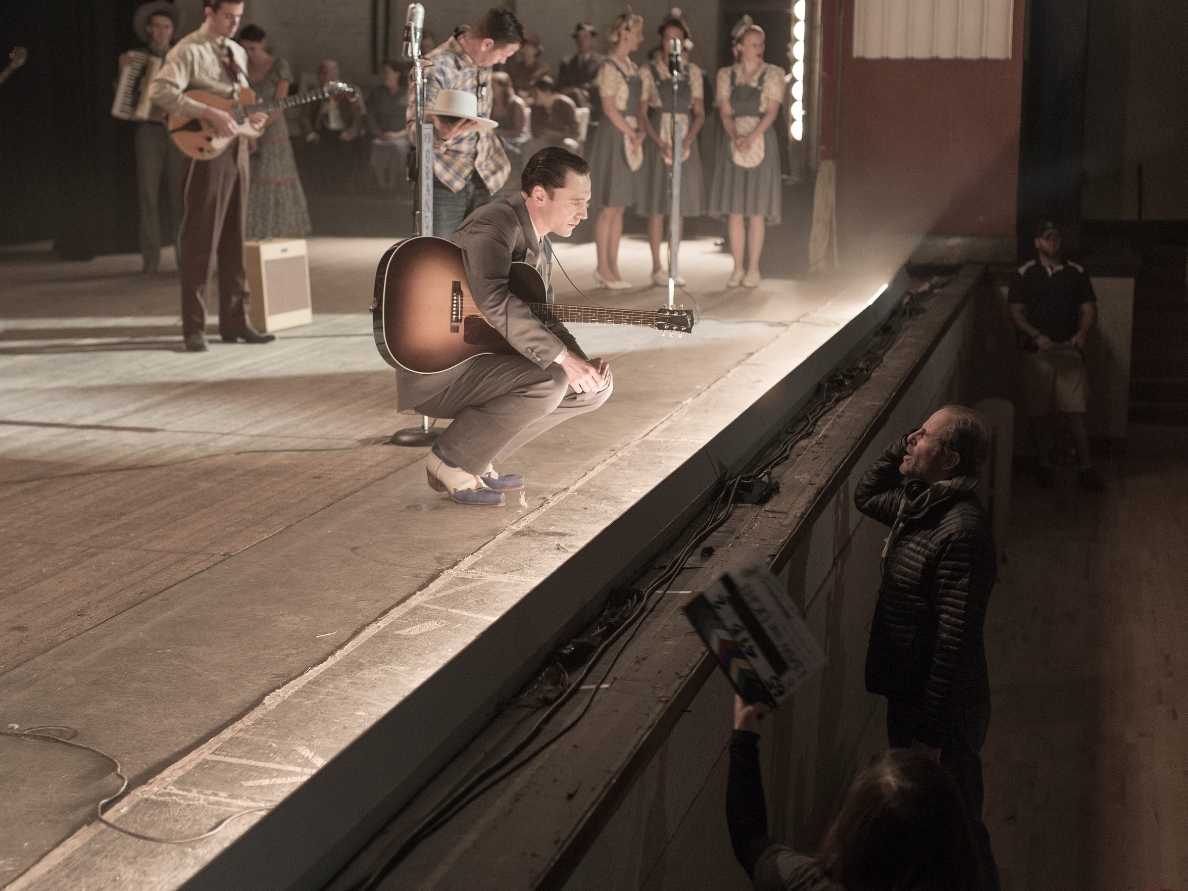 "Left to right: Tom Hiddleston as Hank Williams and director Marc Abraham talk at Shreveport Municipal Memorial Auditorium while filming ""I Saw the Light."""