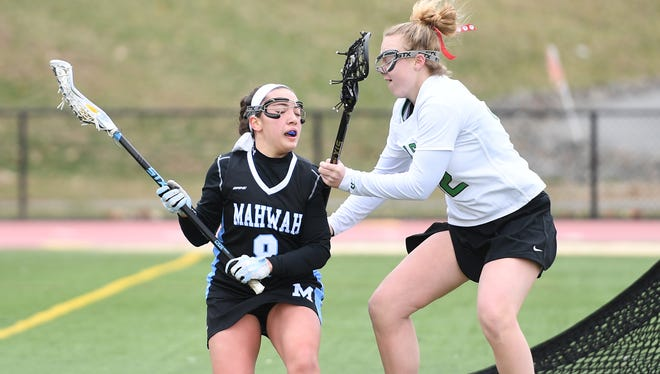 Mahwah at Pascack Valley on Saturday, April 7, 2018. (left) M #8 Olivia Huss and PV #32 Nicole Arden.