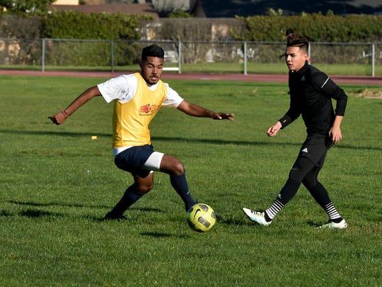 Diego Caballero (left) defends against teammate Ernie