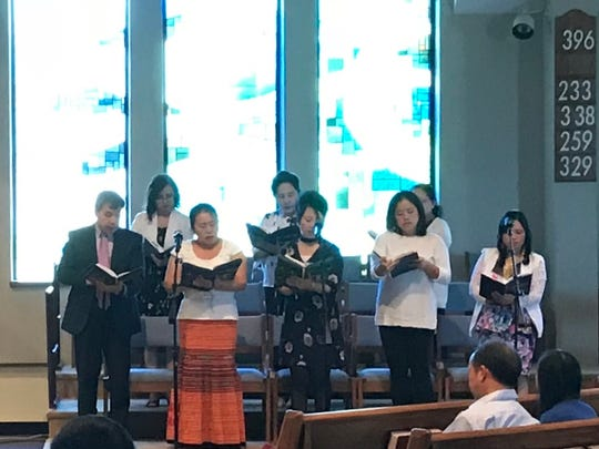 The choir sings at the Hmong bilingual Mass celebrated Sunday, May 13, at St. Anne Parish in Wausau.