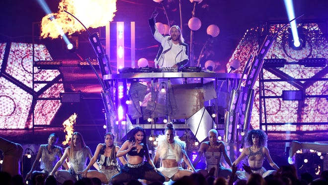 Nicki Minaj, center left, and David Guetta, top, perform at the Billboard Music Awards at the MGM Grand Garden Arena on Sunday, May 17, 2015, in Las Vegas.