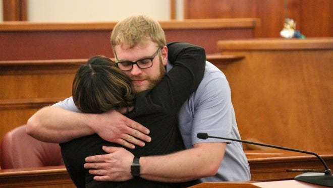 Steffen Heacock hugs probation officer Callie Moss during the Adult Treatment Court graduation ceremony Wednesday afternoon in the Oakland County Courthouse in Pontiac.