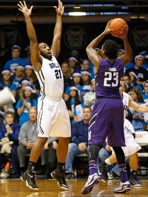 Butler's Roosevelt Jones guards Northwestern's JerShon Cobb in the first half of a game on Dec. 6, 2014 at Hinkle Fieldhouse. Butler won 65-56.