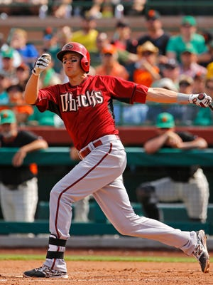 Arizona Diamondbacks shortstop Nick Ahmed (13) hits in the 5th inning against the San Francisco Giants during their spring training game Tuesday, March 17, 2015 at Salt River Fields at Talking Stick.