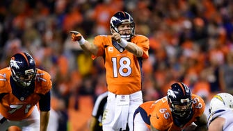 Denver Broncos quarterback Peyton Manning calls out an audible in the third quarter against the San Diego Chargers at Sports Authority Field at Mile High. The Broncos defeated the Chargers 35-21. Mandatory Credit: Ron Chenoy-USA TODAY Sports ORG XMIT: USATSI-180224 ORIG FILE ID:  20141023_ajw_ac4_301.JPG