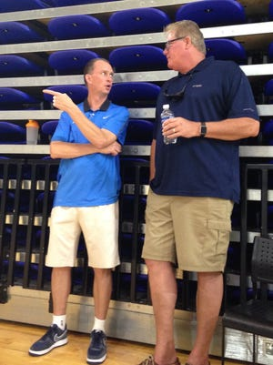 FGCU coach Joe Dooley, left, talks with Richard Doyle, father of Michigan transfer and FGCU signee Ricky Doyle, during FGCU team camp Friday, June, 17, 2016, in Alico Arena.