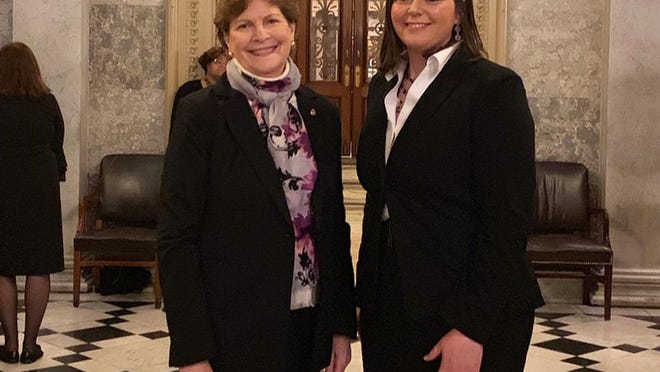 Portsmouth resident Andrea Amico, right, co-founder of Testing for Pease, with Sen Jeanne Shaheen.