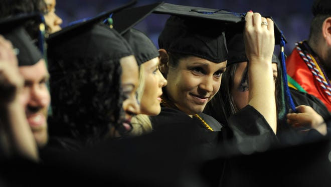 Graduates move their tassels over Saturday during the University of West Florida Commencement at the Pensacola Bay Center.