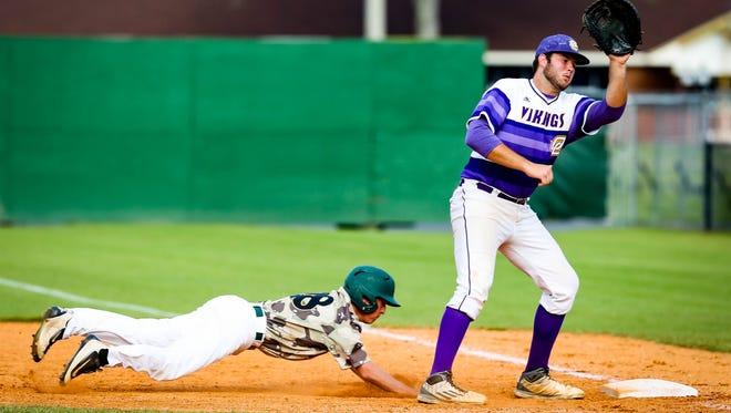 First baseman Spencer Gardner receives the throw from catcher Sam Jarrell as an Acadiana baserunner dives back to first base.