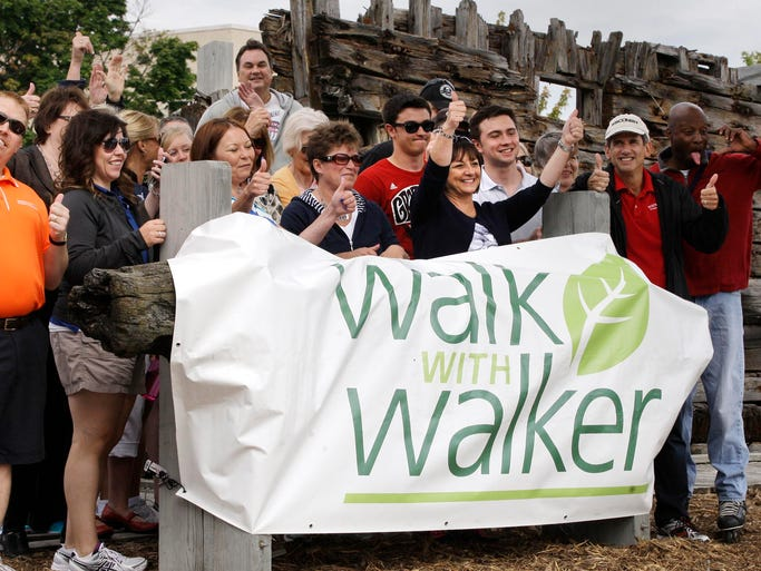Wisconsin First Lady Tonette Walker (center with thumbs up) visited Sheboygan to get in some exercise during one of her regular Walk with Walker events Friday July 26, 2014 at Deland Park in Sheboygan.  Walker says the event is an effort to get people out, exercise and enjoy places in Wisconsin.