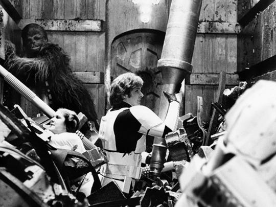 """""""Star Wars"""" Harrison Ford, Peter Mayhew, and Carrie Fisher in Star Wars: Episode IV - A New Hope."""