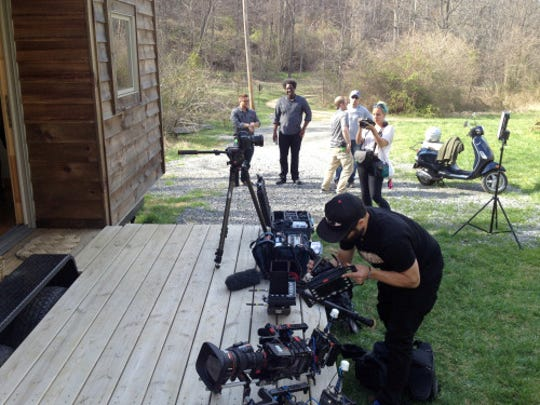 """A CNN film crew films outside Natalie Pollard's tiny home in Asheville. The crew was in Asheville recently for the filming of a new documentary series entitled """"United Shades of America."""""""
