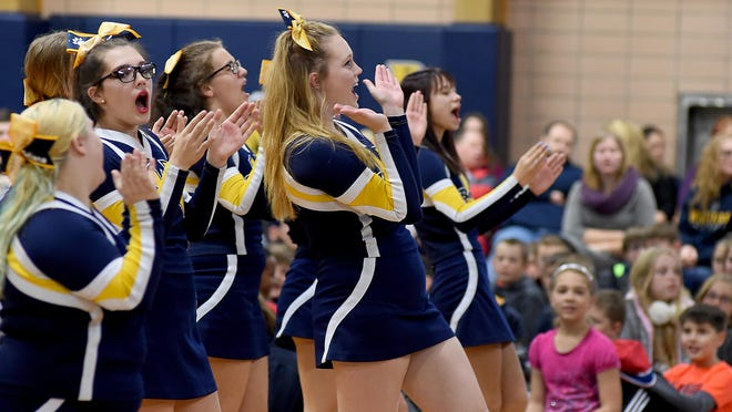 Whiteford High School cheerleaders lead the crown in a few cheers during a pep rally in 2012. Whiteford is exploring the idea of adding a competitive cheer team and resurrecting wrestling and golf.