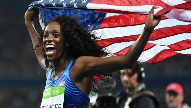 Aug 18, 2016; Rio de Janeiro, Brazil;  Ashley Spencer (USA) wins bronze in the women's 400m hurdles final during track and field competition in the Rio 2016 Summer Olympic Games at Estadio Olimpico Joao Havelange.