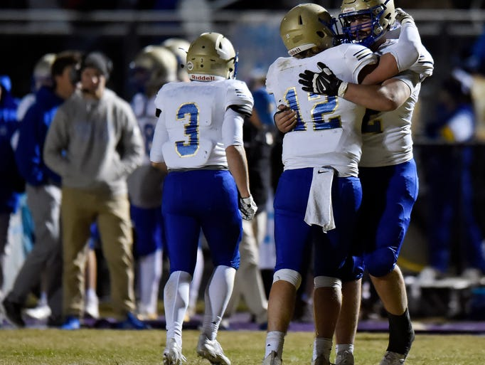 Brentwood tackle Cole Mabry, right, consoles Brentwood