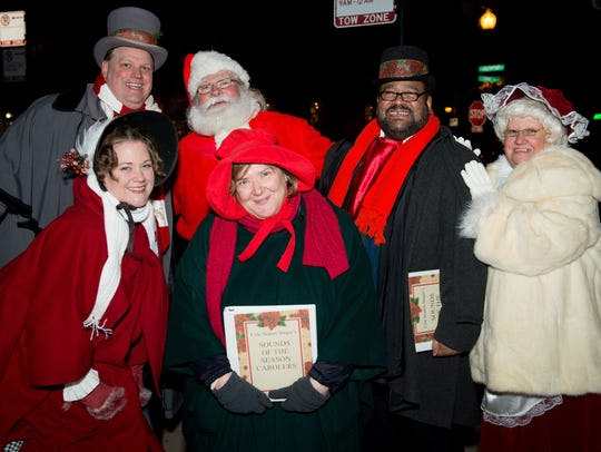 Carolers gather during the 2015 Southport Holiday Stroll.