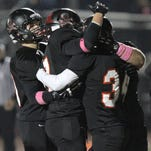 Pinckney's Blake Duke (34), scored one of five second-quarter touchdowns in Pinckney's 38-21 win at South Lyon East on Friday night.