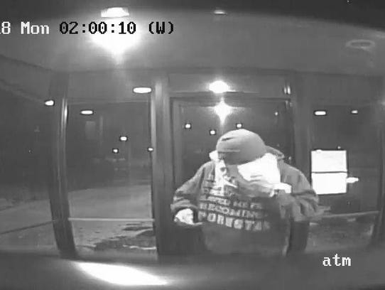 Surveillance photos of a man police say broke into