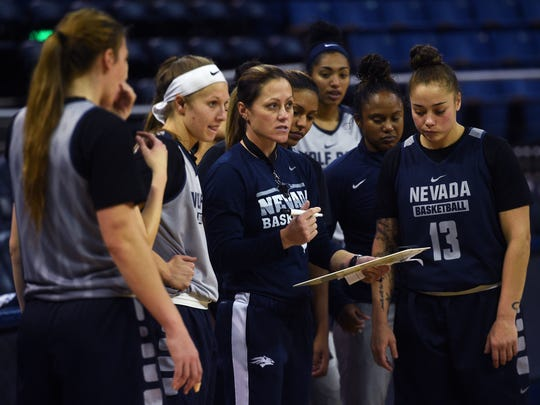 Nevada women's basketball coach Amanda Levens, center, talks to her players during practice.