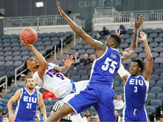 Tennessee State's Armani Chaney takes an off-balanced shot against Eastern Illinois' Aboubacar Diallo in Wednesday night's first round game of the Ohio Valley Conference at Ford Center in Evansville, Ind.