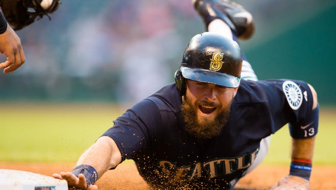 Dustin Ackley of the Seattle Mariners dives back to first base on a pick-off attempt during the fourth inning against the Cleveland Indians at Progressive Field on June 10, 2015 in Cleveland, Ohio. The Yankees acquired Ackley Thursday, July 30, 2015.