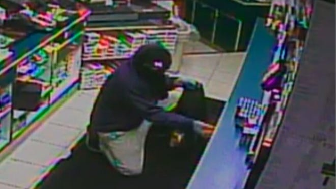 Police are asking for the public's assistance in identifying a person who stole more than 50 cartons of cigarettes during a December burglary.