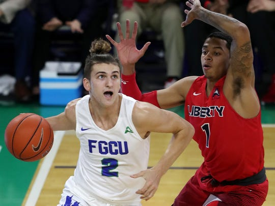 FGCU's Caleb Catto scores against Liberty on Saturday at Alico Arena in Fort Myers. Liberty beat FGCU 81-63.