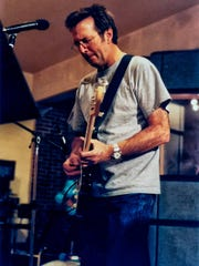 Eric Clapton records a guitar track at Showplace Recording Studios in Victory Gardens.