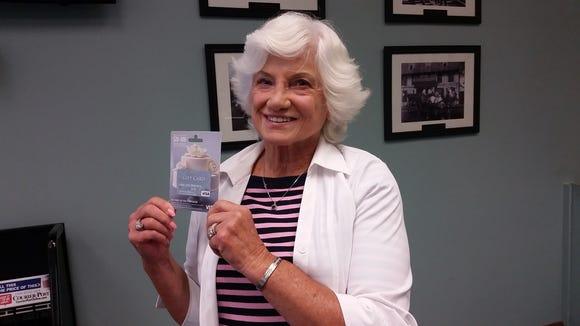 Joyce Nelson picks up her $100 gift card for Cherry Hill Restaurant Week.