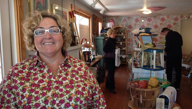 Pixie Windsor, owner of Miss Pixieâ??s By the Sea, stands inside her vintage furnishings store.