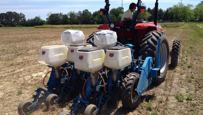 Chuck Dickson does a test run of a new planter for peanuts at the IFAS North Florida Research and Education Center in Quincy. The center is the local research and technology partner in the Grow Gadsden initiative.