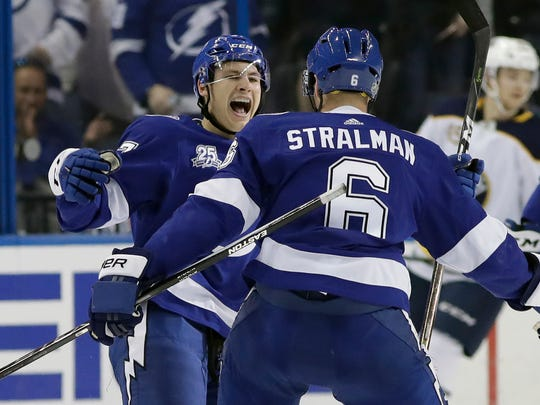 Tampa Bay Lightning center Yanni Gourde, left, celebrates his goal against the Buffalo Sabres with defenseman Anton Stralman during the first period of an NHL hockey game Friday, April 6, 2018, in Tampa, Fla. (AP Photo/Chris O'Meara)