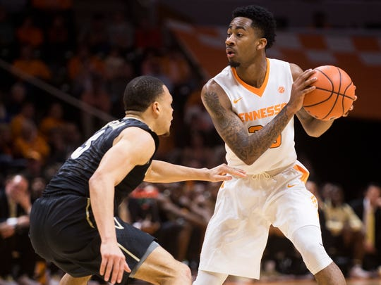 Tennessee guard Jordan Bowden (23) looks for an open teammate while defended by Vanderbilt guard Larry Austin, Jr. (3) during Tennessee's home basketball game against Vanderbilt at Thompson-Boling Arena on Tuesday, January 23, 2018.
