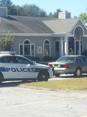Police investigate a robbery at a Putnam County Savings