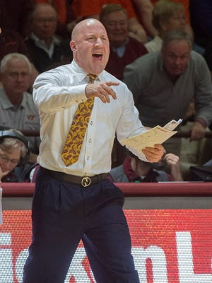 Virginia Tech's head coach Buzz Williams yells to his players during the second half of Saturday's game against Miami.  (AP Photo/Don Petersen)