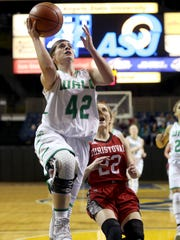 Wall's Kelsey Powers goes up for a layup in action