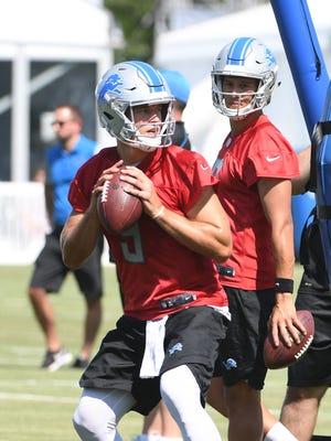 Lions quarterback Matthew Stafford throws, with rookie QB Brad Kaaya looking on during practice.