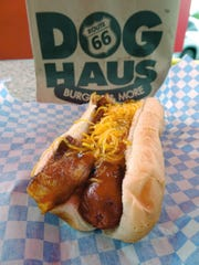 The hickory bacon dog from Route 66 Dog Haus is slathered