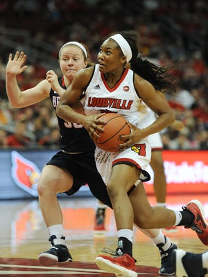 Louisville's Taylor Johnson (front) drives against Belmont's Darby Maggard (in back) on Sunday at the KFC Yum! Center. Nov. 13, 2016